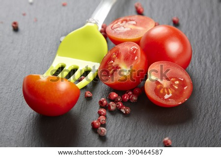 Red fresh tomatoes on chopping board with knife,shallow focus - stock photo
