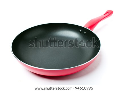 Red frying pan with a nonstick coating - stock photo