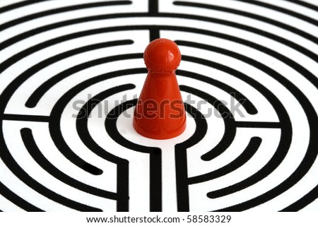 red game figurine in labyrinth, centered - stock photo