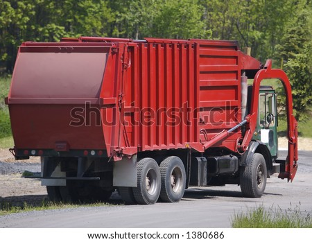 Red Garbage Truck - stock photo
