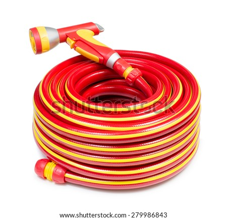 Red garden coiled hose with handle isolated  - stock photo
