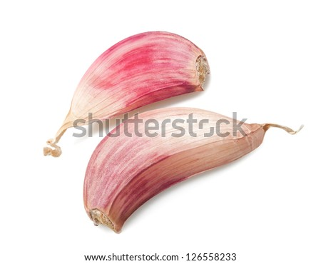 Red garlic cloves isolated on white - stock photo