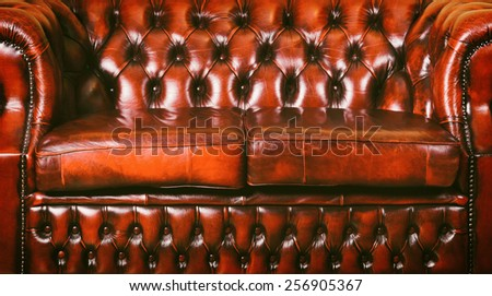 Red Genuine Leather Sofa Near The Wall - stock photo