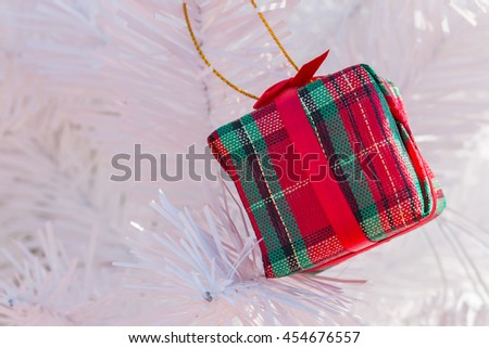 Red gift box on Christmas tree background - stock photo