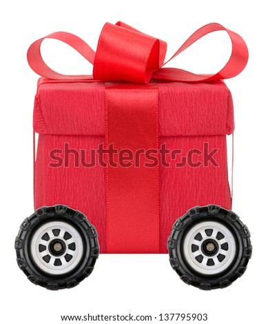Red gift box on wheels - stock photo