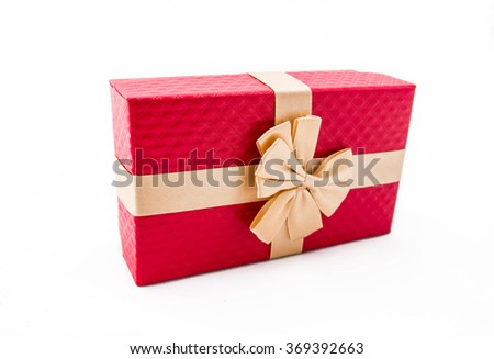 Red gift box with gold ribbon on white background. - stock photo
