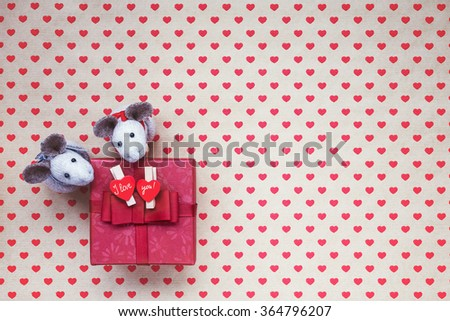 Red gift box with hearts on hearts background. Copy space - stock photo