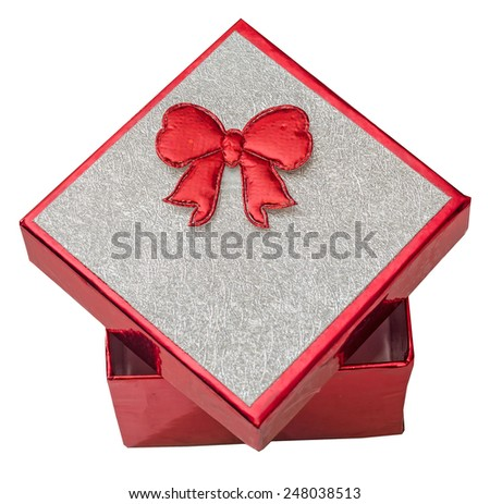 Red gift box with shinny silver cover and red bow, close up, isolated - stock photo