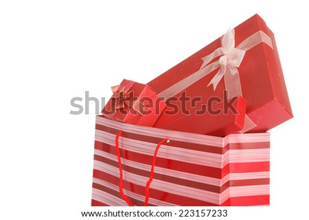 Red gift boxes  in red shopping bag on white background - stock photo