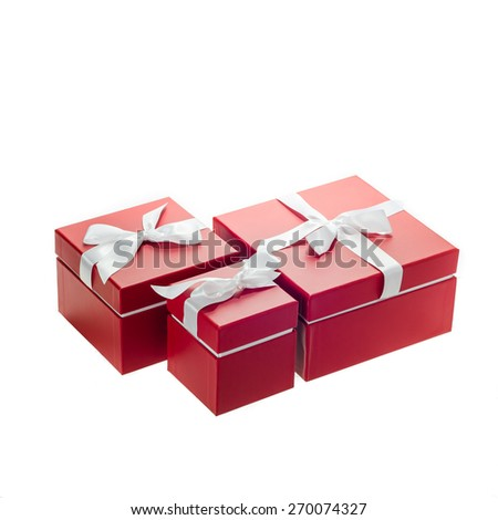 Red gift boxes on white background - stock photo