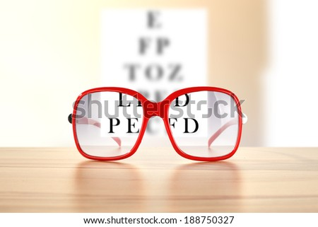 red glasses and text  - stock photo