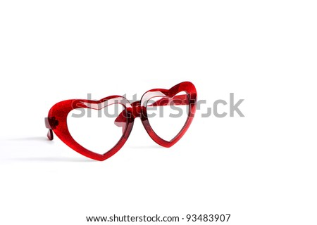 red glasses with heart shape glass isolated on white - stock photo