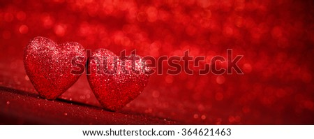 Red glitter background with hearts,valentines day concept. - stock photo