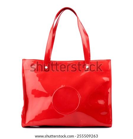 Red glossy female handbag isolated on white background. - stock photo