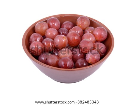 Red Grapes in a bowl, isolated on a white background  - stock photo