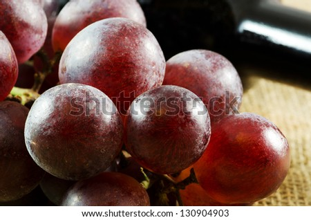 Red grapes on a jute texture - stock photo