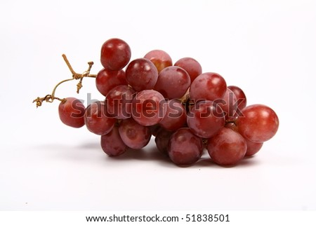 Red grapes on white background - stock photo