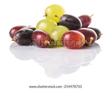 Red, green and black grapes fruits over white background - stock photo