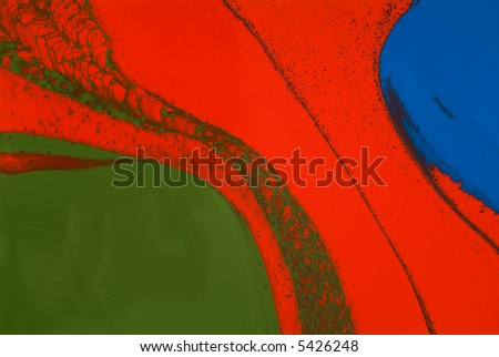 Red, green and blue paints spilled and mixed on a white background, close-up - stock photo