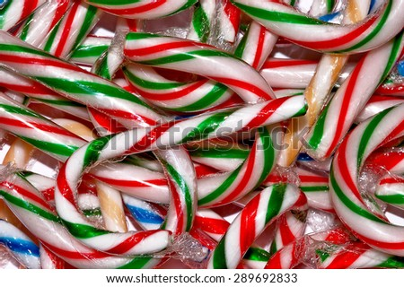Red, green and white striped christmas candy canes - stock photo