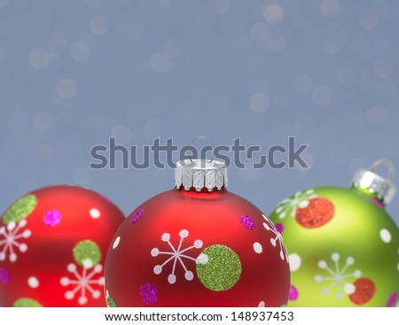 Red & green Christmas balls on blue abstract background with copy space. Shallow DOF.  - stock photo