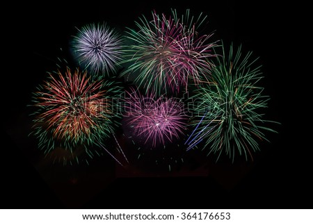 Red, green, purple, lilac fireworks over night sky. Celebration beautiful colorful fireworks. Salute of various colors in the night sky, Light show. 4th of July, 4 of July. Independence day, New Year - stock photo
