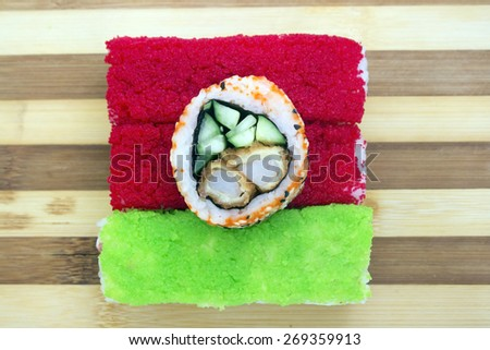 red green rolls on a cutting board - stock photo