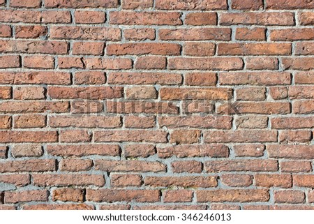 Red grunge brick wall texture. - stock photo