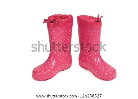 Red gumboots with spots on a white background. Clipping path included. - stock photo