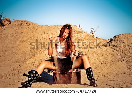 red hair beautiful woman waste sand,  outdoor shot summer day - stock photo