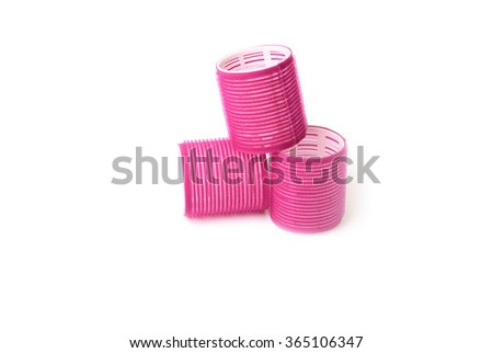 Red Hair curlers over a white background - stock photo