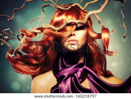 Red Hair. Fashion Model Woman Portrait with Long Curly Red Hair on Wood Branches. Autumn. Hair Extension  - stock photo