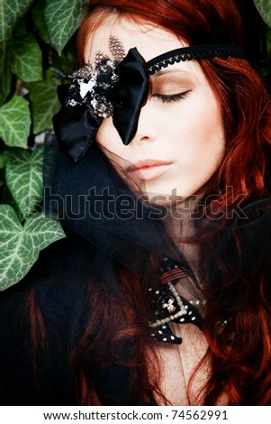red hair fashion woman outdoor portrait with decorative bow over eye - stock photo
