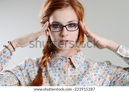 red hair girl with glasses - stock photo