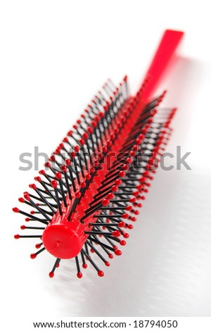 Red hairbrush isolated on the white background - stock photo