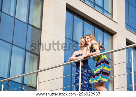 red haired girls friends laughing and hug outdoors - stock photo