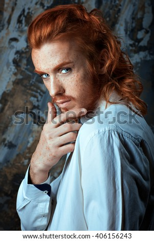 Red-haired man with a beard and mustache, he is metrosexual. - stock photo