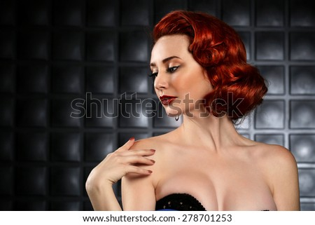 Red Haired Pinup Fashion Model on Styled Set - stock photo