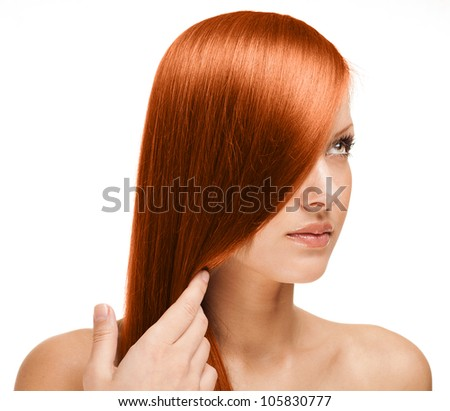 red haired woman holding her long straight hair - stock photo