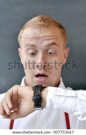 Red-haired young guy late for meet - stock photo