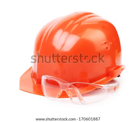 Red hard hat and glasses. Isolated on a white background. - stock photo