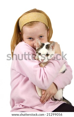 red head girl holding a white cat on white - stock photo