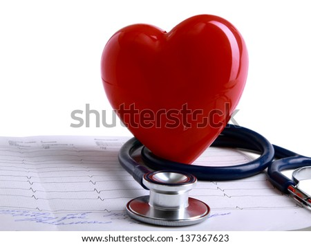 Red heart and a stethoscope on cardiogram - stock photo