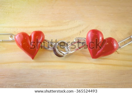 Red heart and ring  with chain. Love concept. - stock photo