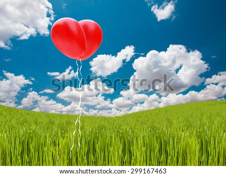red heart balloon on  Grass hill and beautiful sky and clouds - stock photo