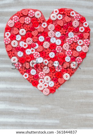 Red heart covered with colorful buttons.Valentine's day. From above - stock photo