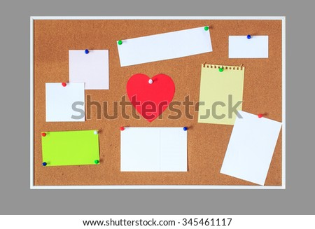 red heart from a paper on a cork board office. a reminder of Valentine's Day, notes and other blank sheets of paper for your text. isolated on gray background - stock photo