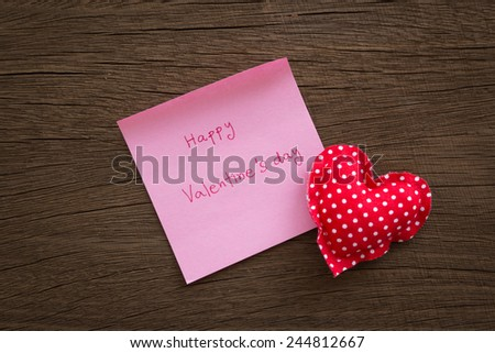 Red heart handmade crafts from polka dot cotton cloth with Happy valentine's day note place on wood background with vignette, wedding and anniversary symbol - stock photo