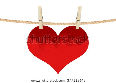 red heart hang on clothespins isolated on the white background - stock photo