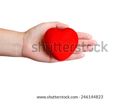 Red heart in a hand isolated on white background - stock photo